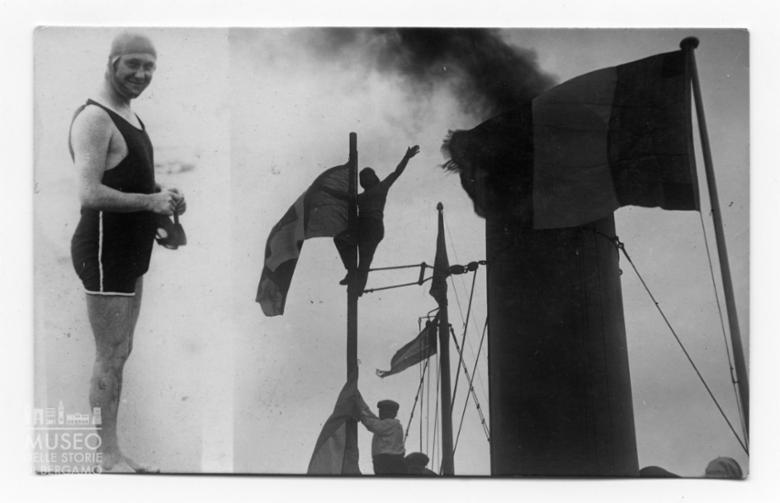 Enrico Tiraboschi in costume da bagno; Due bandiere italiane sventolano sul battello